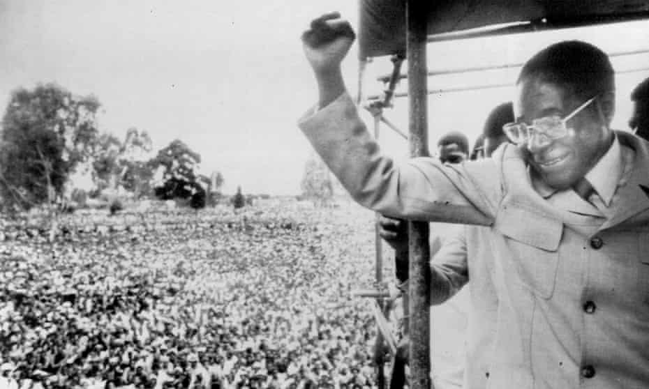 Robert Mugabe saluting supporters in Salisbury (now Harare) after returning to the country from exile to fight the general election.