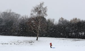 A boy heads out to use his sledge in Danbury, Essex