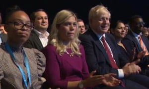 Jayde Edwards, far left, one seat away from Boris Johnson during the Conservative party conference. Mario Creatura appears in the row behind, to the right of Edwards.