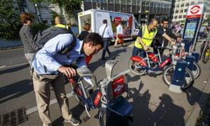 Commuters hiring Boris bikes outside Waterloo Station.
