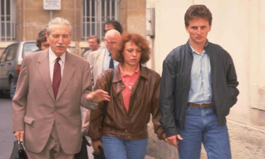 Christine and Jean-Marie Villemin, centre and right, attend a court hearing following the murder of their four-year-old son.