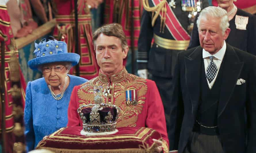 The Queen and Prince Charles walking through the Royal Gallery in Parliament before her speech.