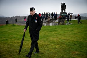 A small number of serving and former Royal Marine commandos gather at Commando Memorial to commemorate and pay respect to service personnel who fought in the two world wars and subsequent conflicts