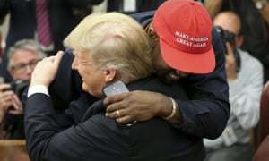 Donald Trump hugs Kanye West during a meeting in the Oval office on 11 October.