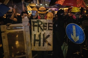 Protesters prepare to face riot police with improvised shields in Hong Kong.