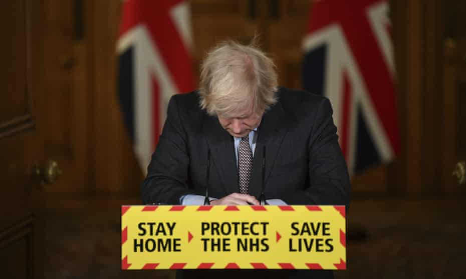 Head bowed, Boris Johnson leads a virtual press conference on the Covid-19 pandemic on Tuesday 26 January.