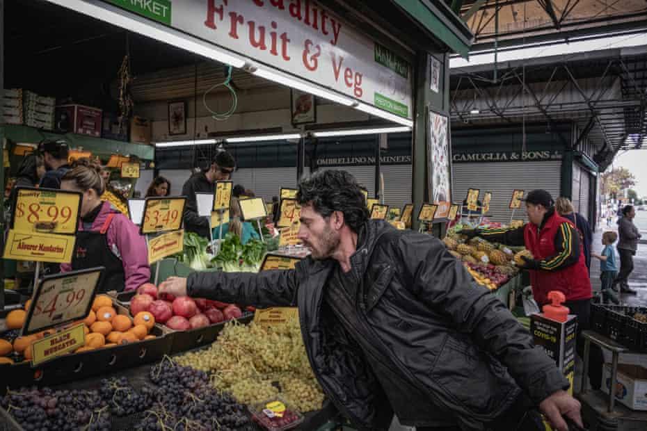 Bandesh buys some fruit at Preston Market, in Melbourne.