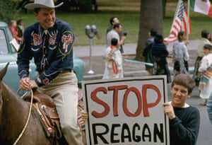 Ronald Reagan campaigning as a gubernatorial candidate, flanked by a young protestor, 1966