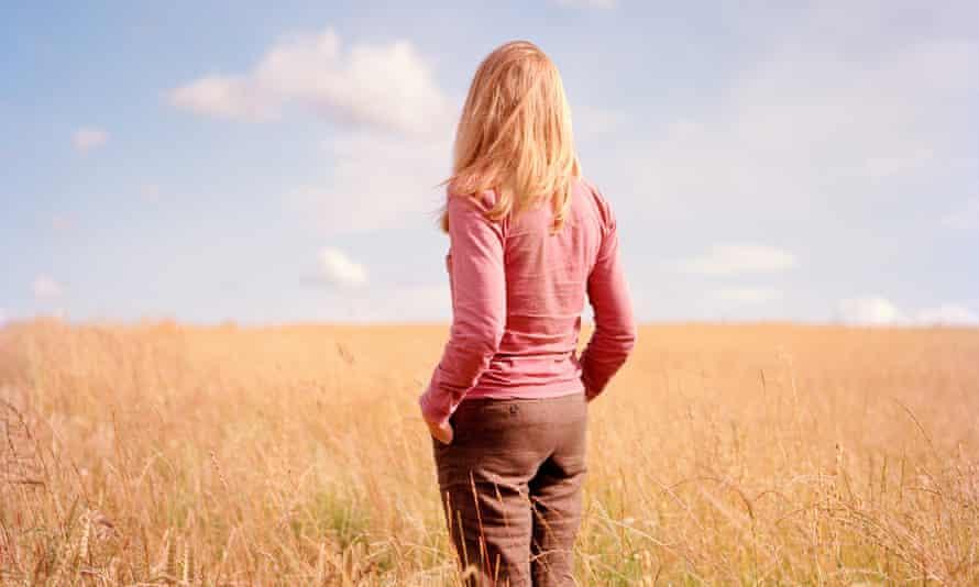 Woman alone in wheat field