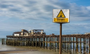 Hastings pier, a historic pier in East Sussex, UK,  fell into disrepair and significant damage was caused by a fire in 2010. This image shows some of the damage.