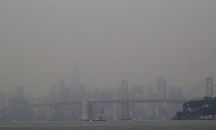 Smoke from wildfires obscures a view of the San Francisco skyline and the San Francisco-Oakland Bay Bridge last month as seen from Oakland, California.
