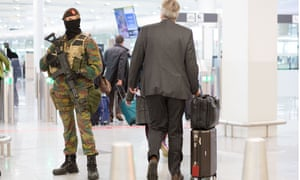 Armed officers at Brussels airport amid heightened security after the Paris terrorism attacks.