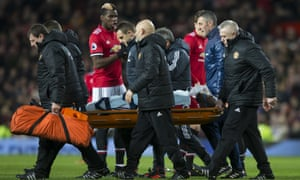 Romelu Lukaku is stretchered off in the first half after a clash of heads with Wesley Hoedt.