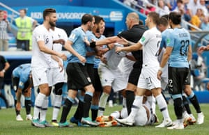 Players clash after France's Kylian Mbappe goes down.