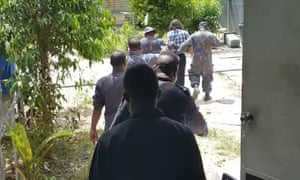 A photo taken by a Manus Island refugee shows Behrouz Boochani being arrested on Thursday