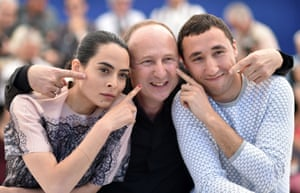 Nailia Harzoune, French director Karim Dridi and French actor Sofian Khammes gesture during a photocall for the film Chouf