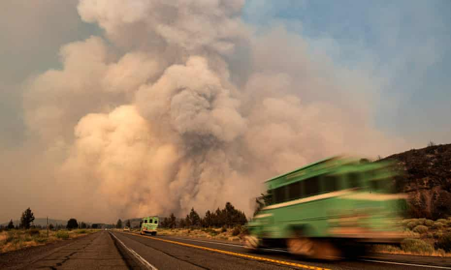 Firefighters in Weed, California rush to tackle a blaze. Research by Herrington affirmed the bleaker scenarios put forward in a landmark 1972 MIT study, The Limits to Growth.