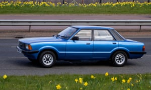 A blue 1979 Ford Cortina Mark IV travelling along the Kingsway dual carriageway in Dundee, UK