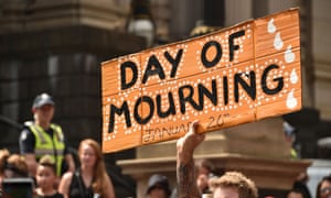 A protester holds up a sign during an 'Invasion Day' rally in Melbourne on January 26 2018. Photograph: Peter Parks/AFP/Getty Images
