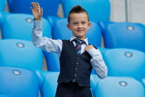 A young Gareth Southgate fan wearing the England manager's signature waistcoat.
