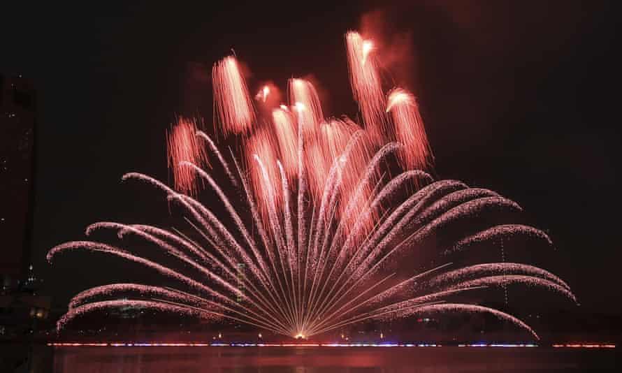 A fireworks display lights up the sky.