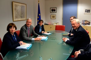 British Secretary of State for Exiting the European Union (Brexit Minister) David Davis (R) and European Union Chief Negotiator in charge of Brexit negotiations with Britain Michel Barnier (2nd L) speak during a meeting at the European Union Commission headquarter in Brussels, July 17, 2017.