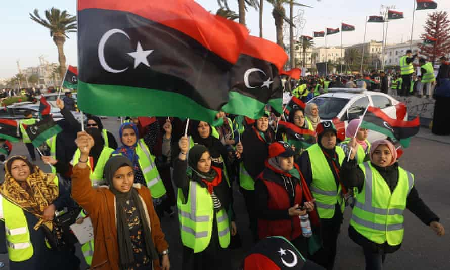 Women wave national flags and chant slogans during an April demonstration against Khalifa Haftar in Martyrs Square, in the LIbyan capital Tripoli