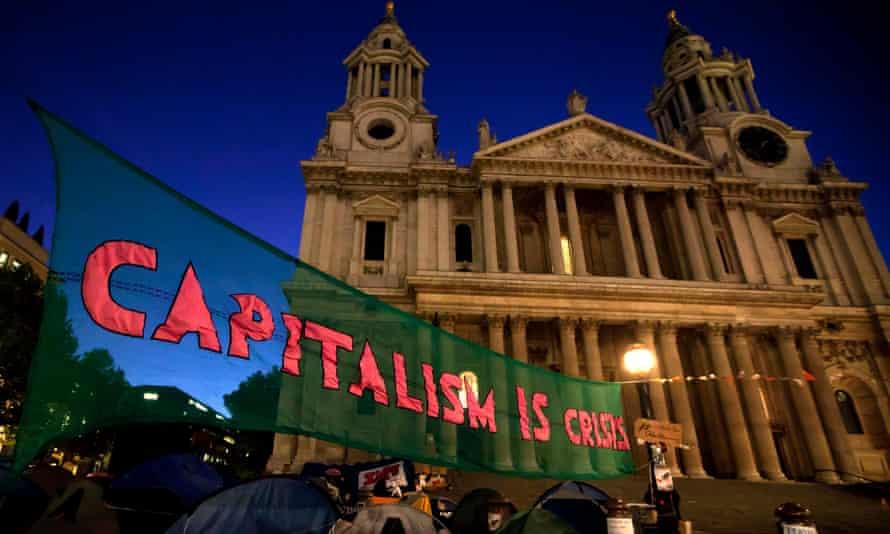 'Capitalism is crisis' sign hangs outside London Stock Exchange.