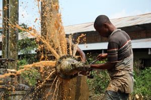 Adji, a technician with Regideso, the public-sector utility company that produces and sitributes water in DRC.