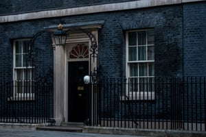 London, England A hard hat is hung on a railing outside the door of number 10 by a workman as a Christmas tree is installed and decorated in Downing Street