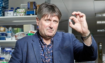 Poet laureate Simon Armitage pictured at London's Institute of Cancer Research, holding the replica anti-cancer pill that has his poem Finishing It engraved on it by micro-artist Graham Short
