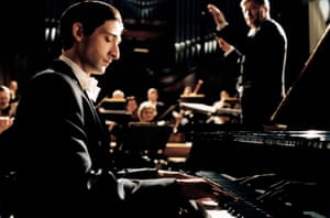 Adrien Brody in The Pianist, directed by Roman Polanski. For his screenplay, Harwood adapted the memoir of Władysław Szpilman.
