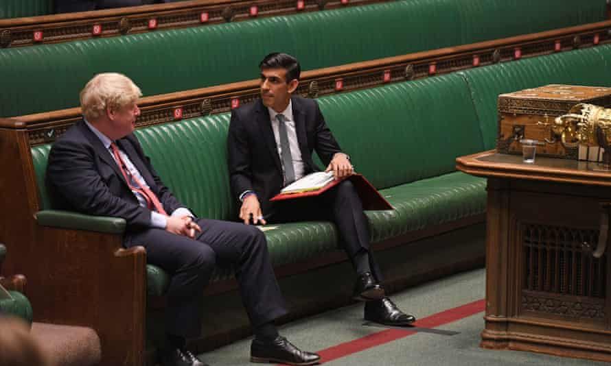 Boris Johnson and Rishi Sunak sitting socially distanced on the green benches of the Commons, talking to each other
