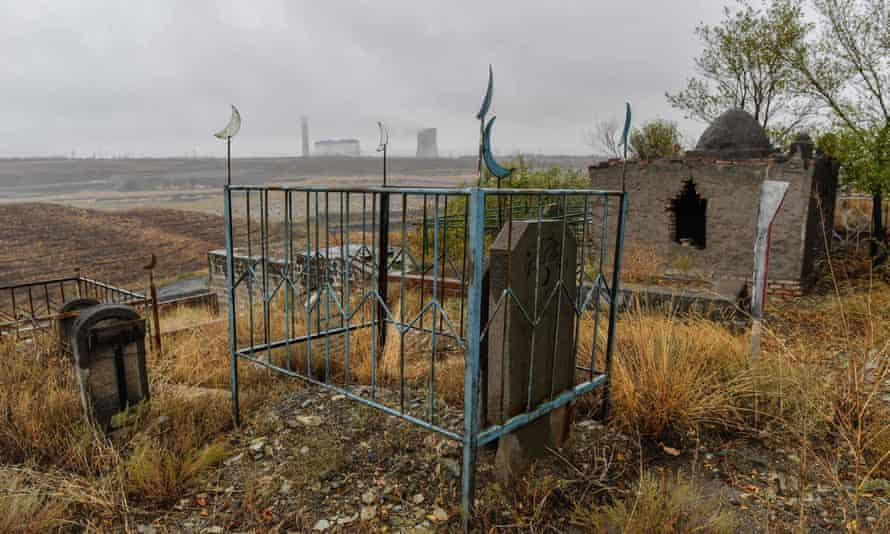 A large Muslim cemetery on the outskirts of Urumqi, the regional capital of Xinjiang. China is destroying burial grounds where generations of Uighur families have been laid to rest.
