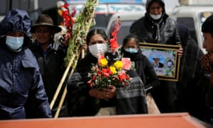 Mourners at a funeral in Bolivia: 'This is worse than the financial crisis of 2008 and for Latin America worse than the debt crisis of the 1980s.'