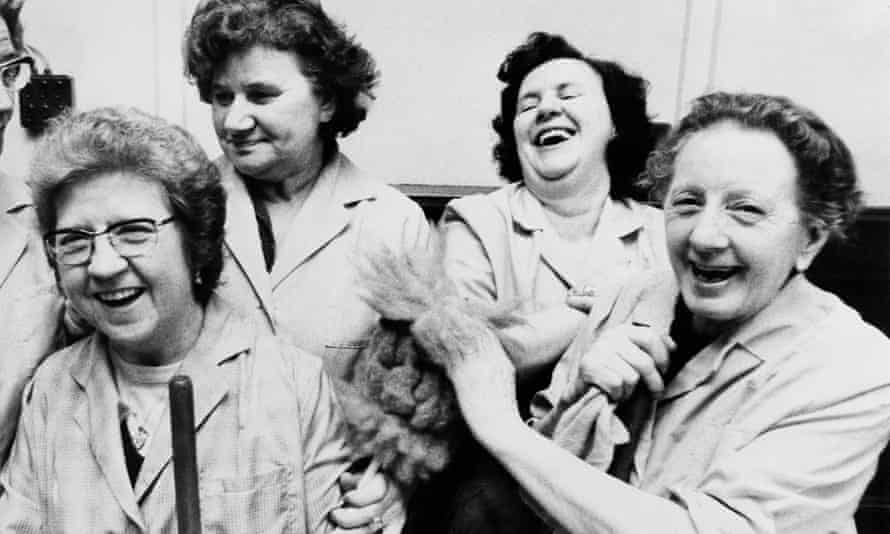 Cleaning women at Kensington town hall, London, celebrate the implementation of the 1970 Equal Pay Act, January 1975