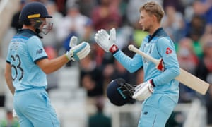 England's Jos Buttler (left) congratulates Joe Root on his century.