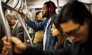 people riding new york subway