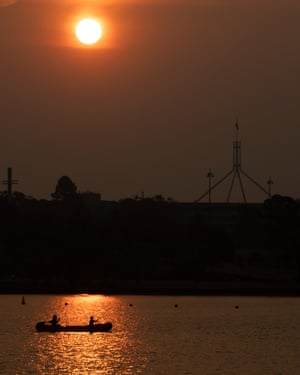 The sun sets through the bushfire smoke haze over Parliament House in Canberra this evening. Monday December 2019. Photograph by Mike Bowers. Guardian Australia