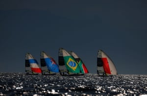 Competitors in action during the men's 49er opening series