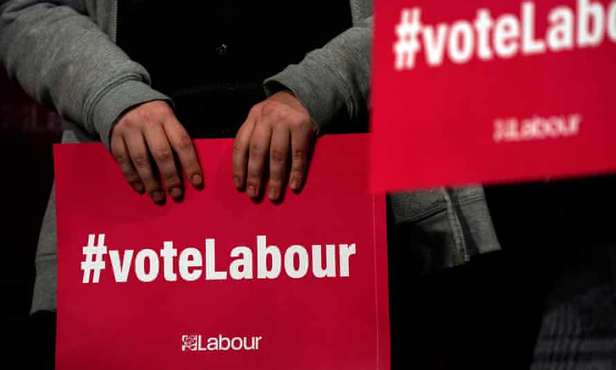Supporters hold Labour party posters