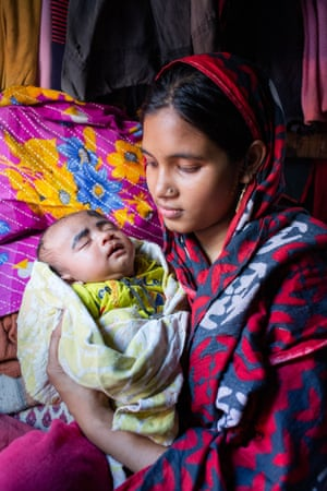 Kobita, 18, with her one-month-old baby Abdur Rahman at her home in Barishal, Bangladesh.