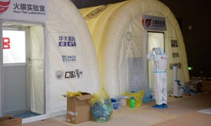 A member of staff works at a Covid-19 testing lab built with an air-inflated structure in Daxing District, Beijing, China, on 22 June 2020.