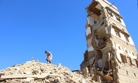 Boy walks on the rubble of a house destroyed by a recent Saudi-led air strike in the northwestern city of Saada, Yemen