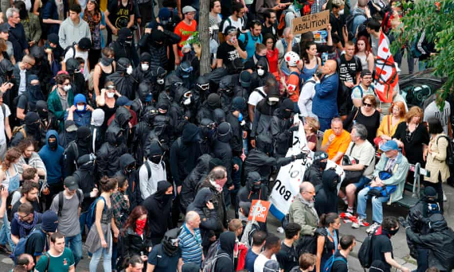 So-called 'Black bloc' anti-capitalists move among marchers converging on the Bastille in Paris on Saturday.