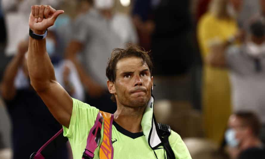 Rafael Nadal waves to the crowd after losing his French Open semi-final to Novak Djokovic
