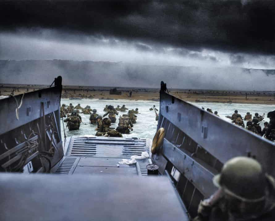 American soldiers disembark on Omaha beach in Normandy on D-day, June 1944: black and white image coloured by artist Marina Amaral