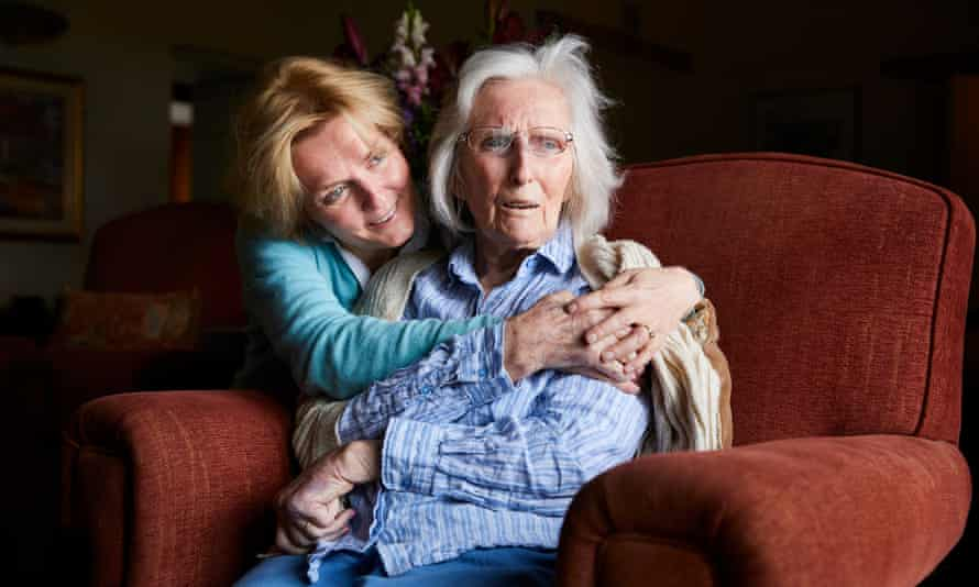 Kate Holt at home in Kentmere, Cumbria, with her mother Shirley who she removed from a care home after becoming concerned for her health.