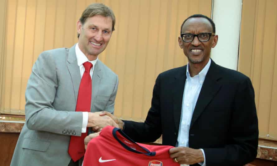 Former Arsenal player Tony Adams with President Paul Kagame