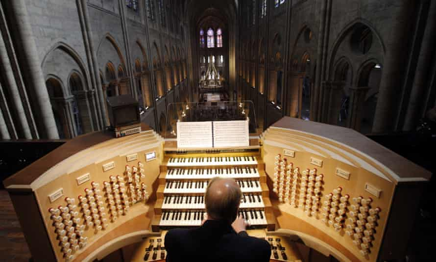 A man plays the organ in Notre Dame. The mammoth task of dismantling, cleaning and reassembling France's largest musical instrument started on Monday.